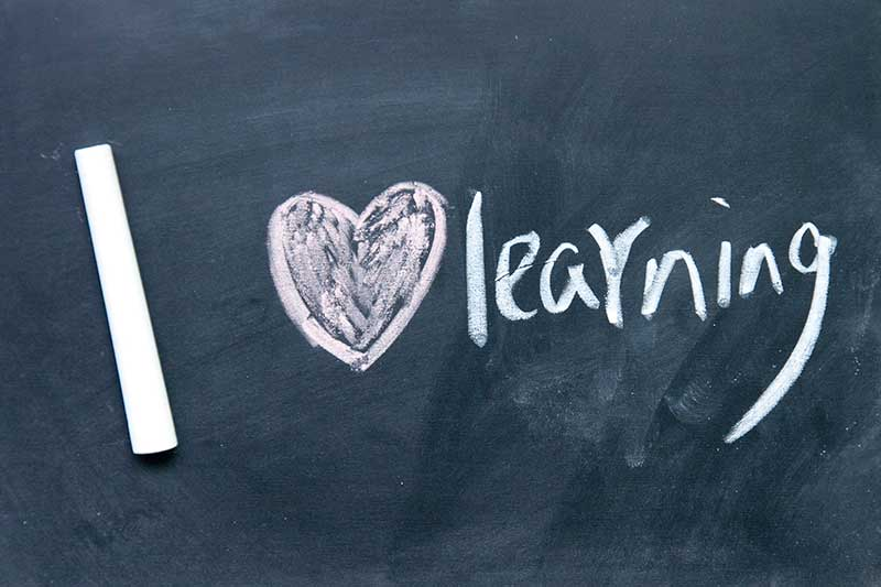 Chalk drawing saying 'I love learning'